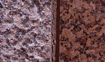 "Granite on the outside wall of The Gallery. Rough ""flamed"" texture left; polished surface right"